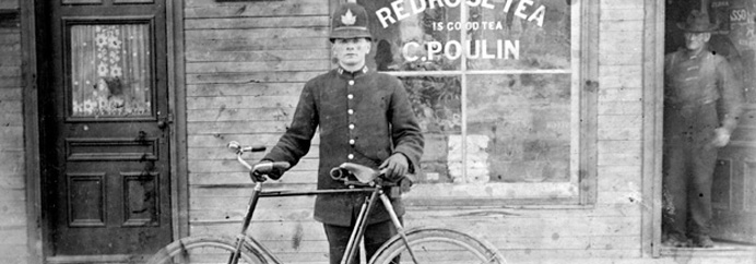 Old photo of officer with a bicycle