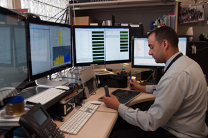 Member of Computer Forensics Unit retrieving evidence from a cellphone.