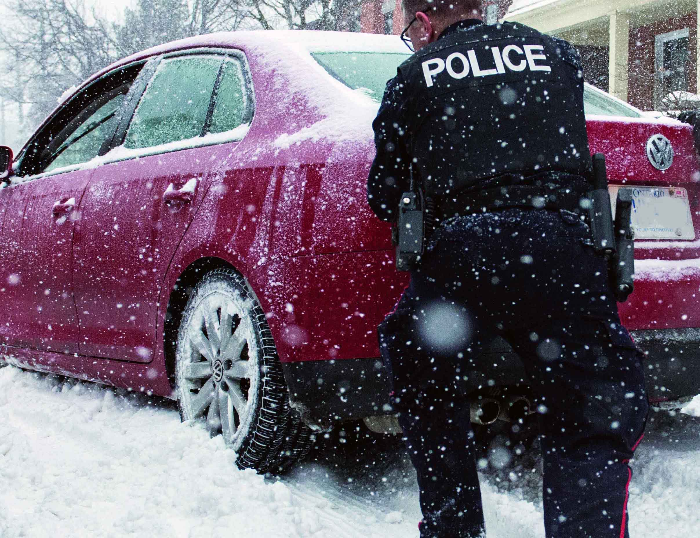 Neighbourhood Resource Team officers help a stranded motorist