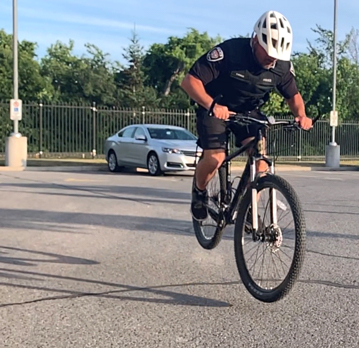 Cst. Forgie demonstrates the two-wheel bunny hop