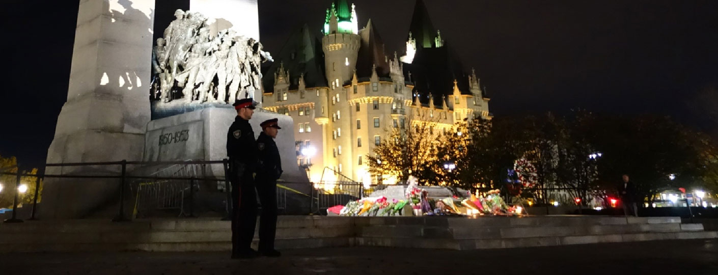 Two police officers standing guard at the Cenotaph war memorial in Ottawa