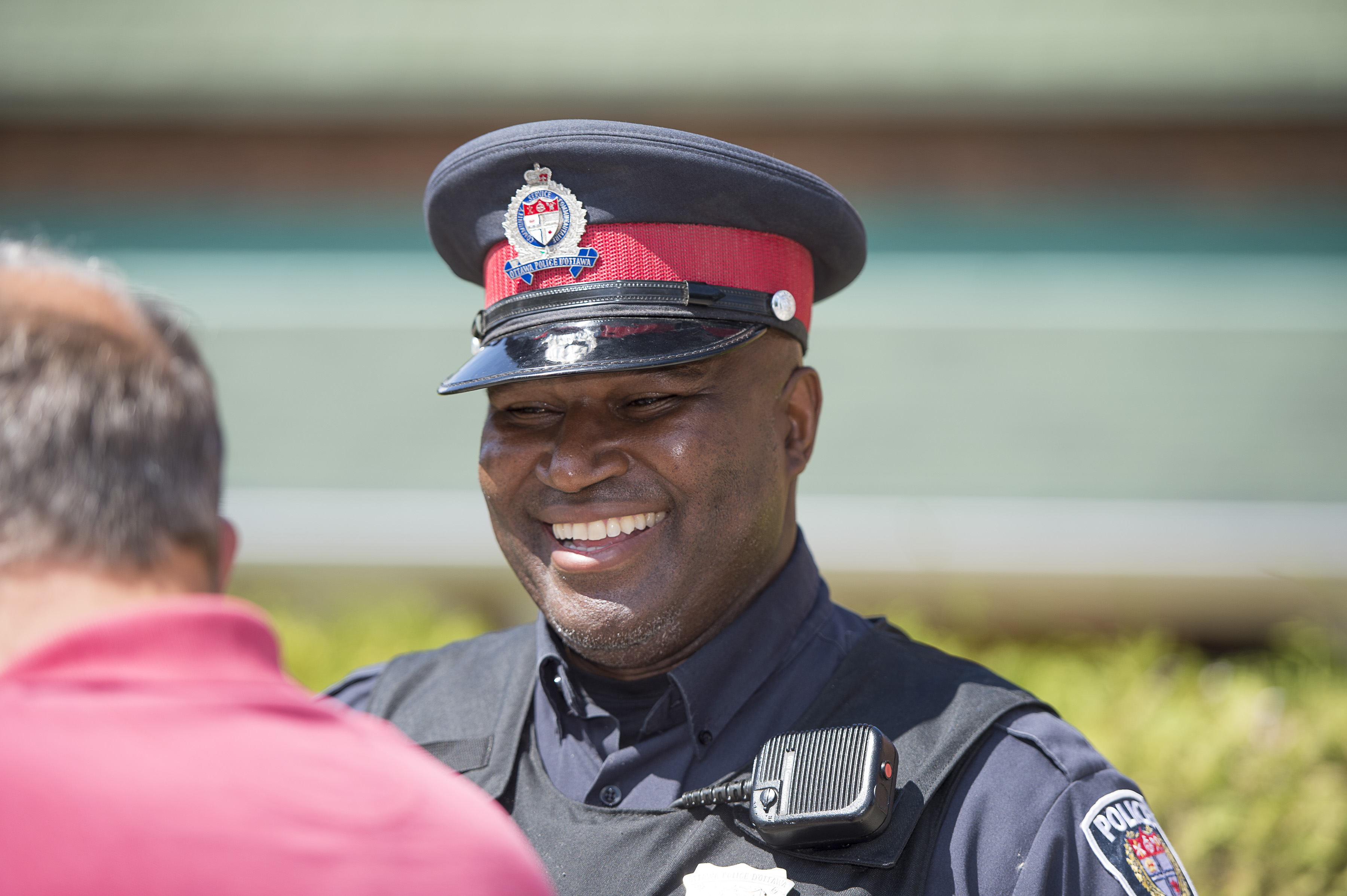 Community Police officer smiling and talking to a member of the public