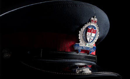 Police hat in front of a dark background