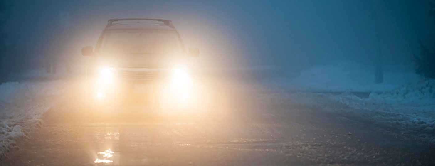 car headlights in foggy weather conditions