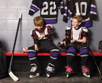 two boys getting ready to play hockey