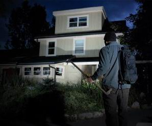 Man approaching a dark house