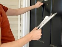Person knocking at door of home