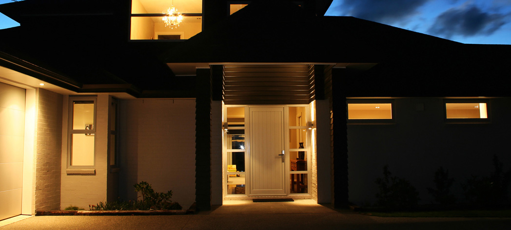 Picture of a home well lit at night