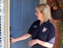 Ottawa Police Volunteer demonstrating home secuirty with proper front door locks.