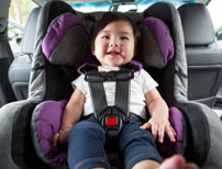Child in a car seat.