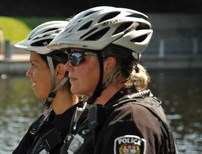 Ottawa Police Officers wearing bike helmets.
