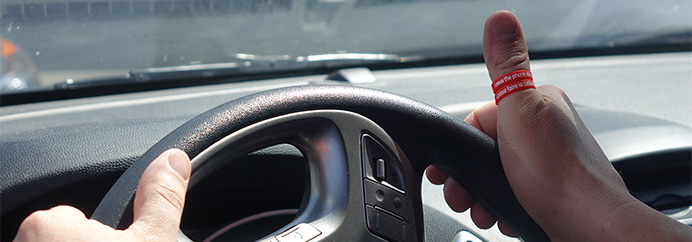 driver hands on steering wheel