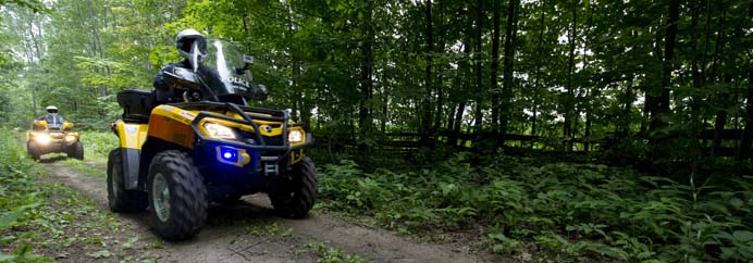 Police officers on ATVs.