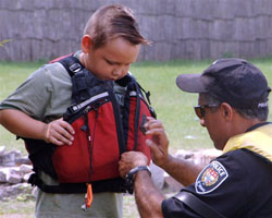 Child being fitted for a lifejacket.
