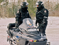 Police Officer on a snowmobile.
