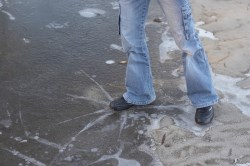 Person stepping on thin ice.